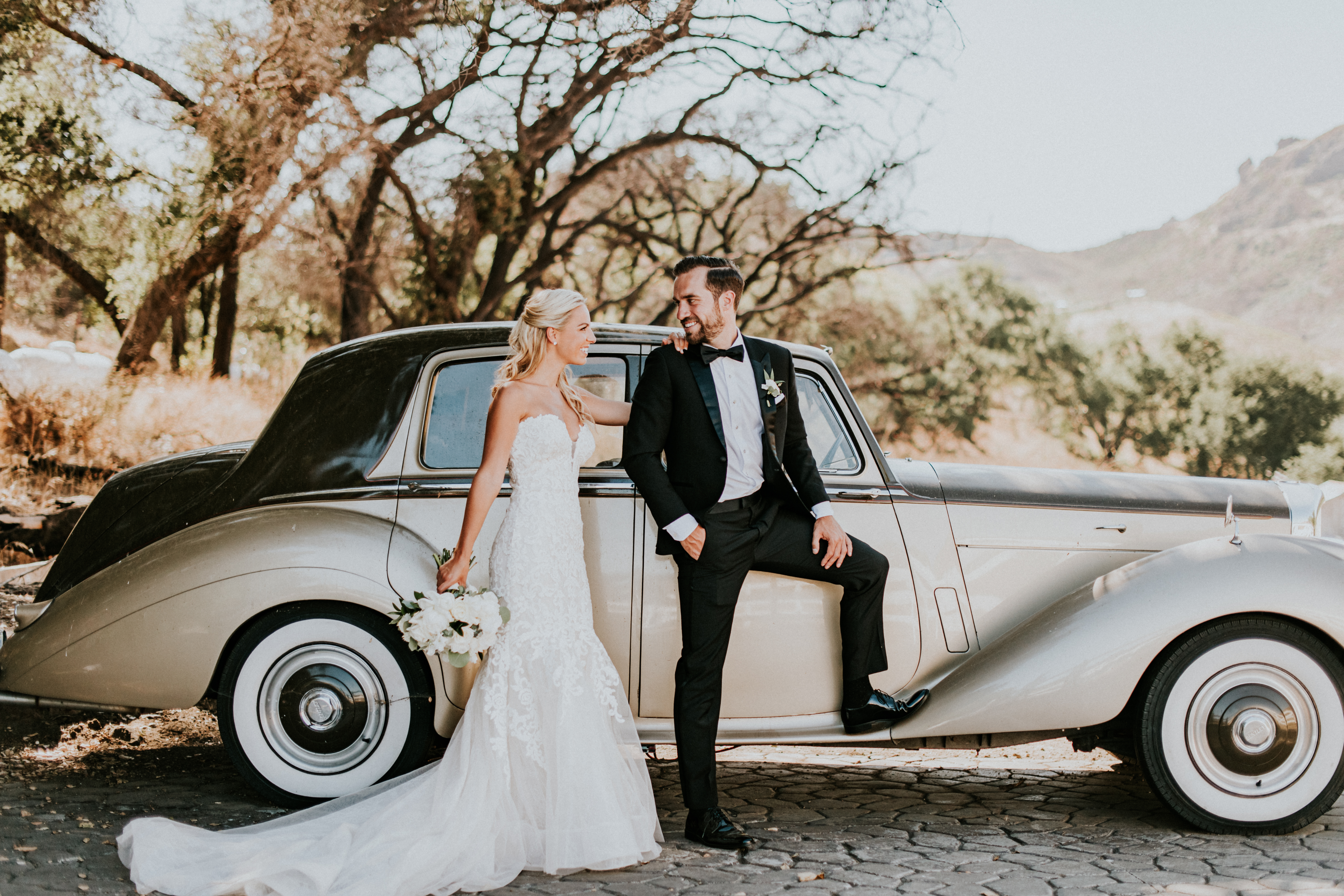 bride and groom posed by car wedding day wedding photography los angeles