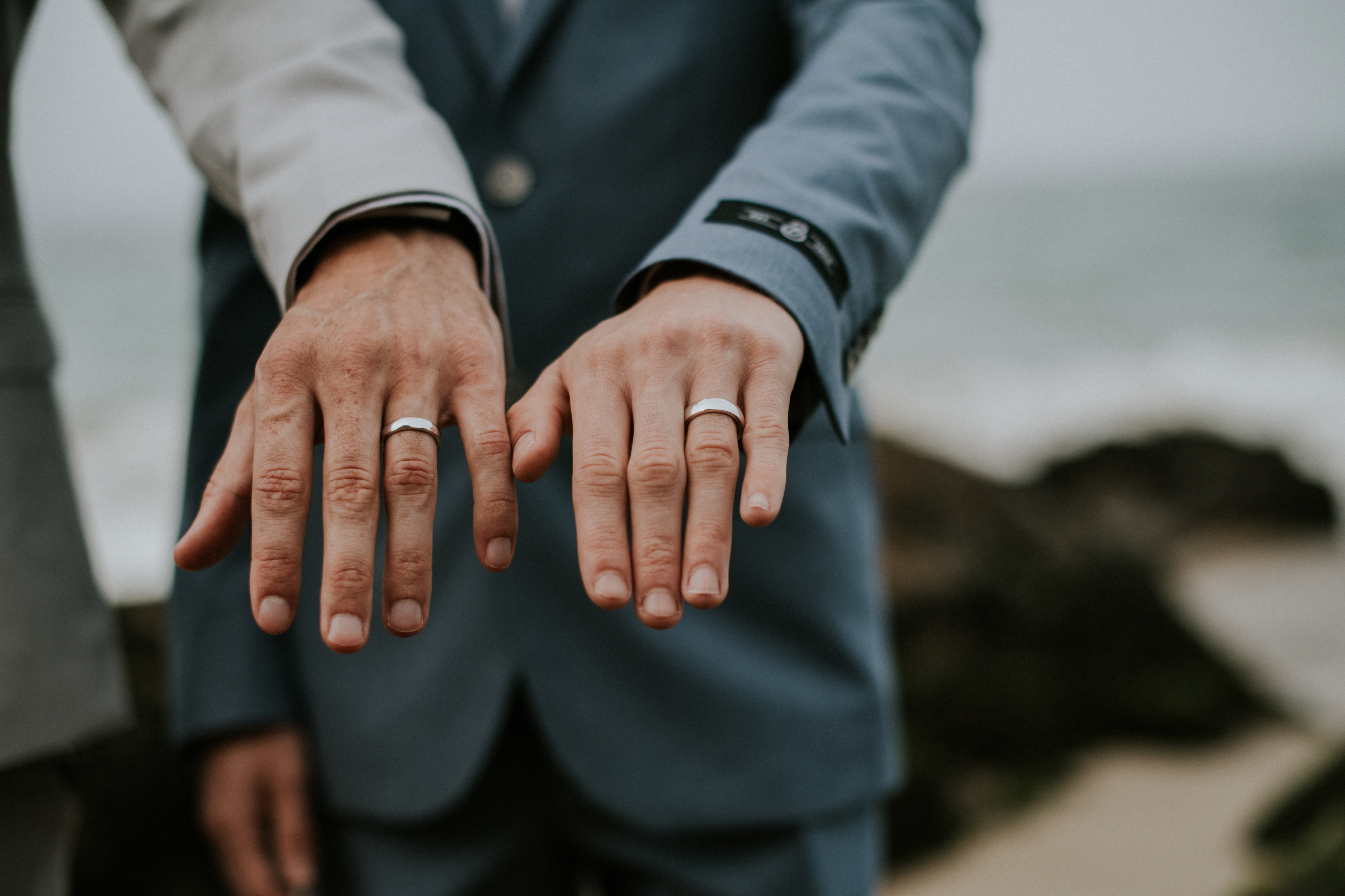 grooms wedding rings detail wedding photography gay wedding point dume beach malibu california