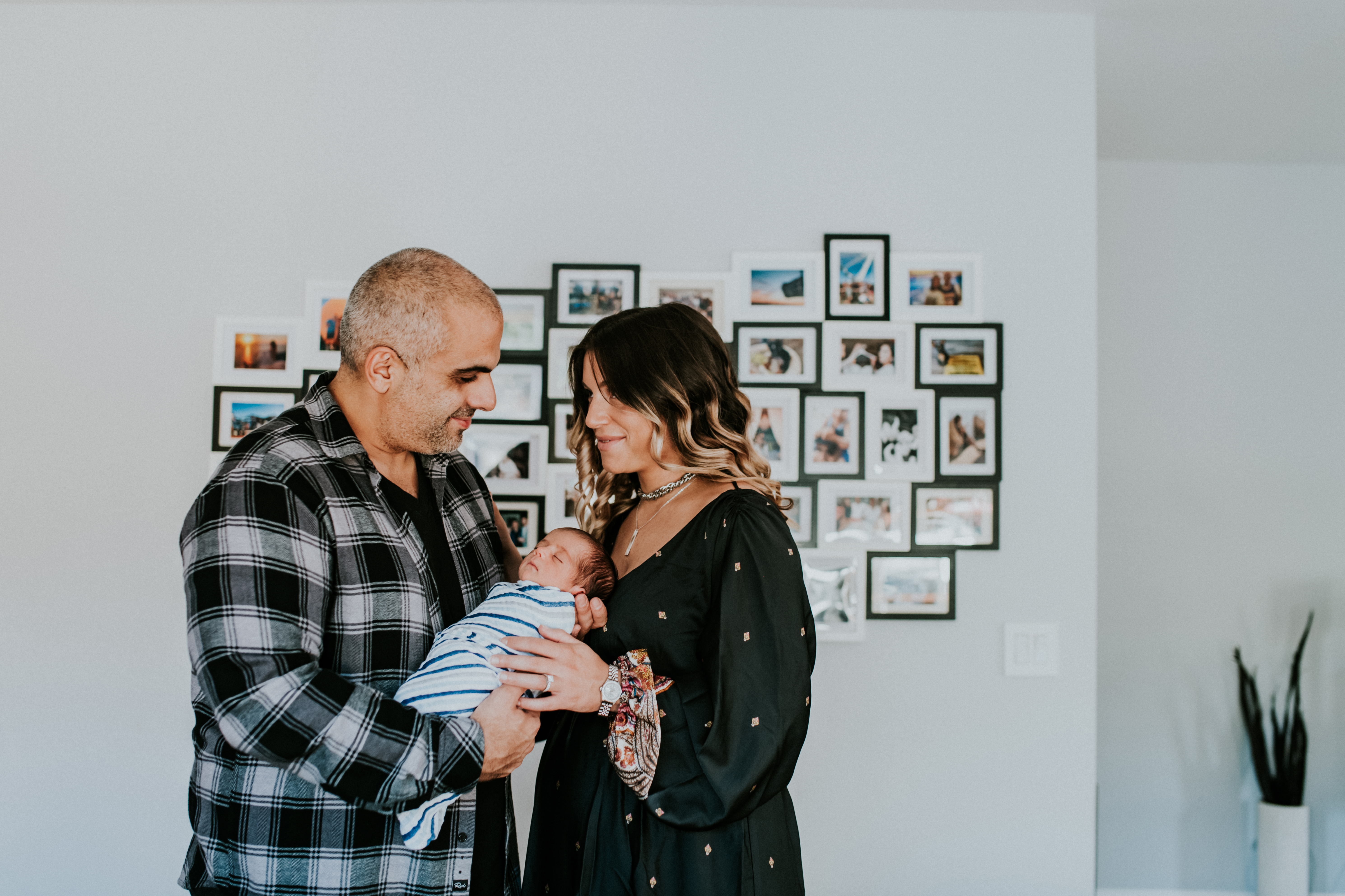 couple holding baby at home lifestyle newborn photography los angeles california