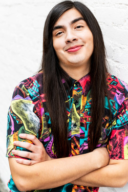 los angeles theatrical commercial headshot for male comedy actor eduardo franco 90s funky shirt city