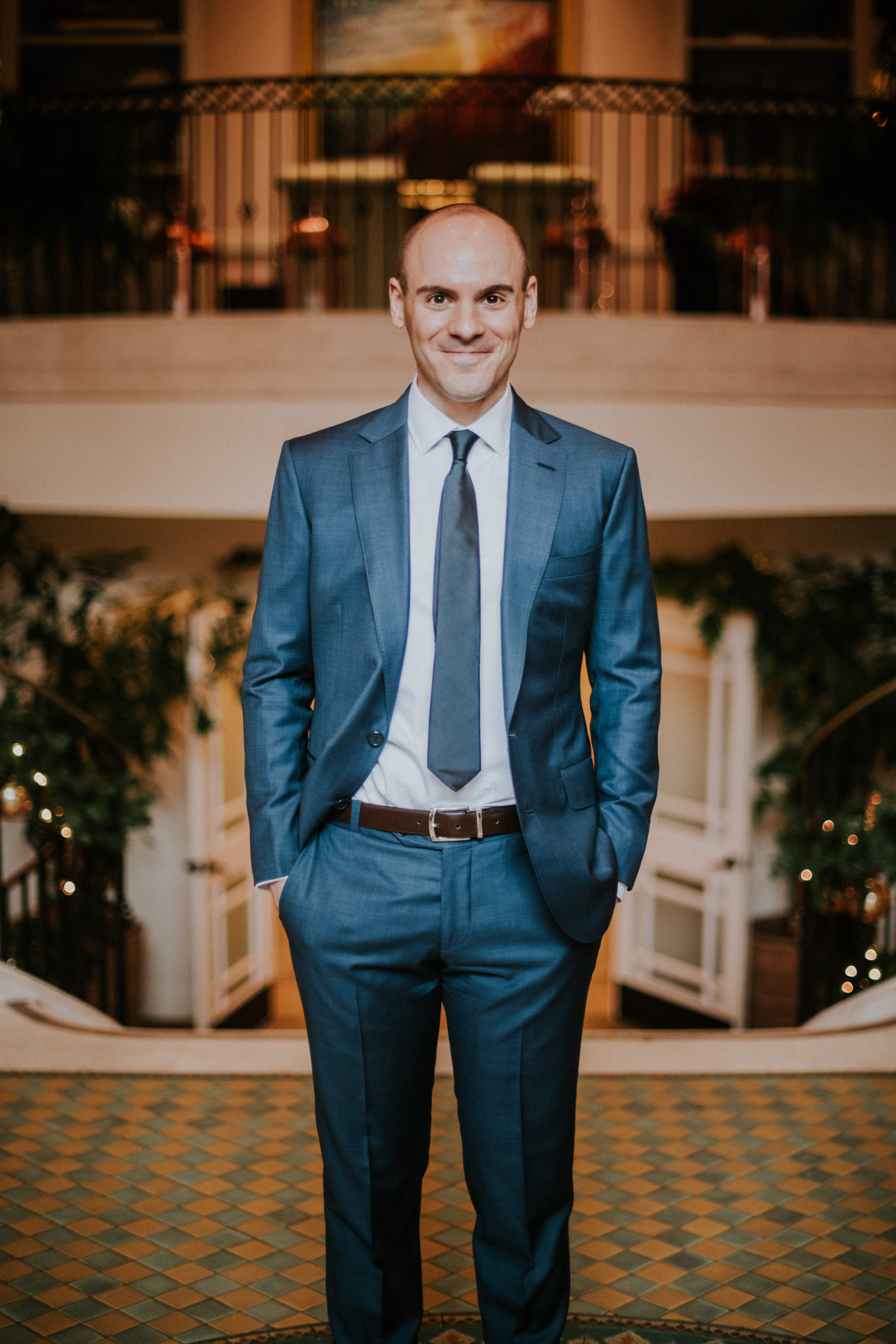 groom posed in blue suit on wedding day photography california wedding hotel casa del mar