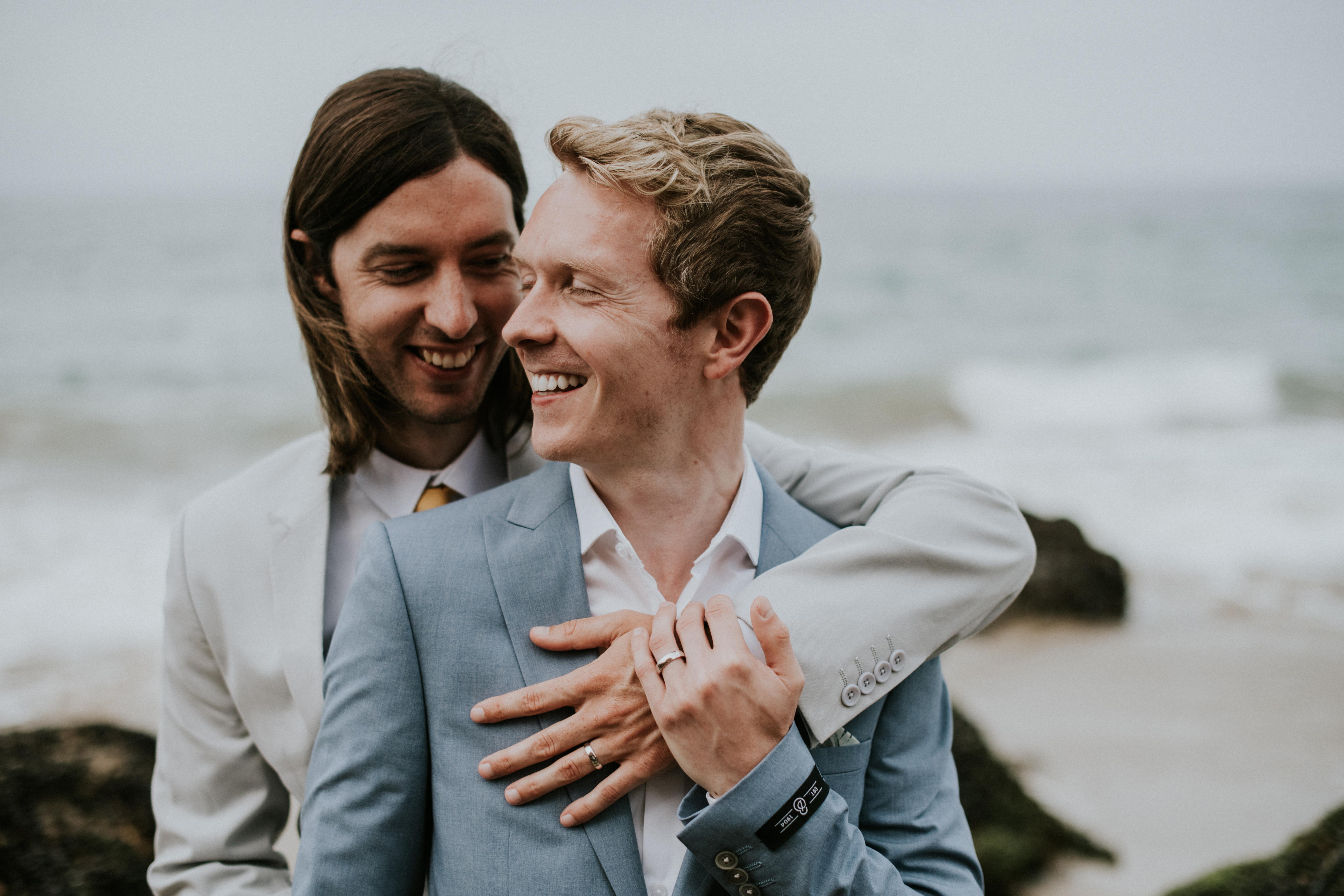 groom and groom posed on beach gay wedding photography point dume beach malibu california