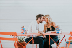 engagement photography photo shoot posed at tables forehead to forehead malibu country mart los ange