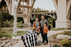 family posed under bridge fall photos family photography pasadena california
