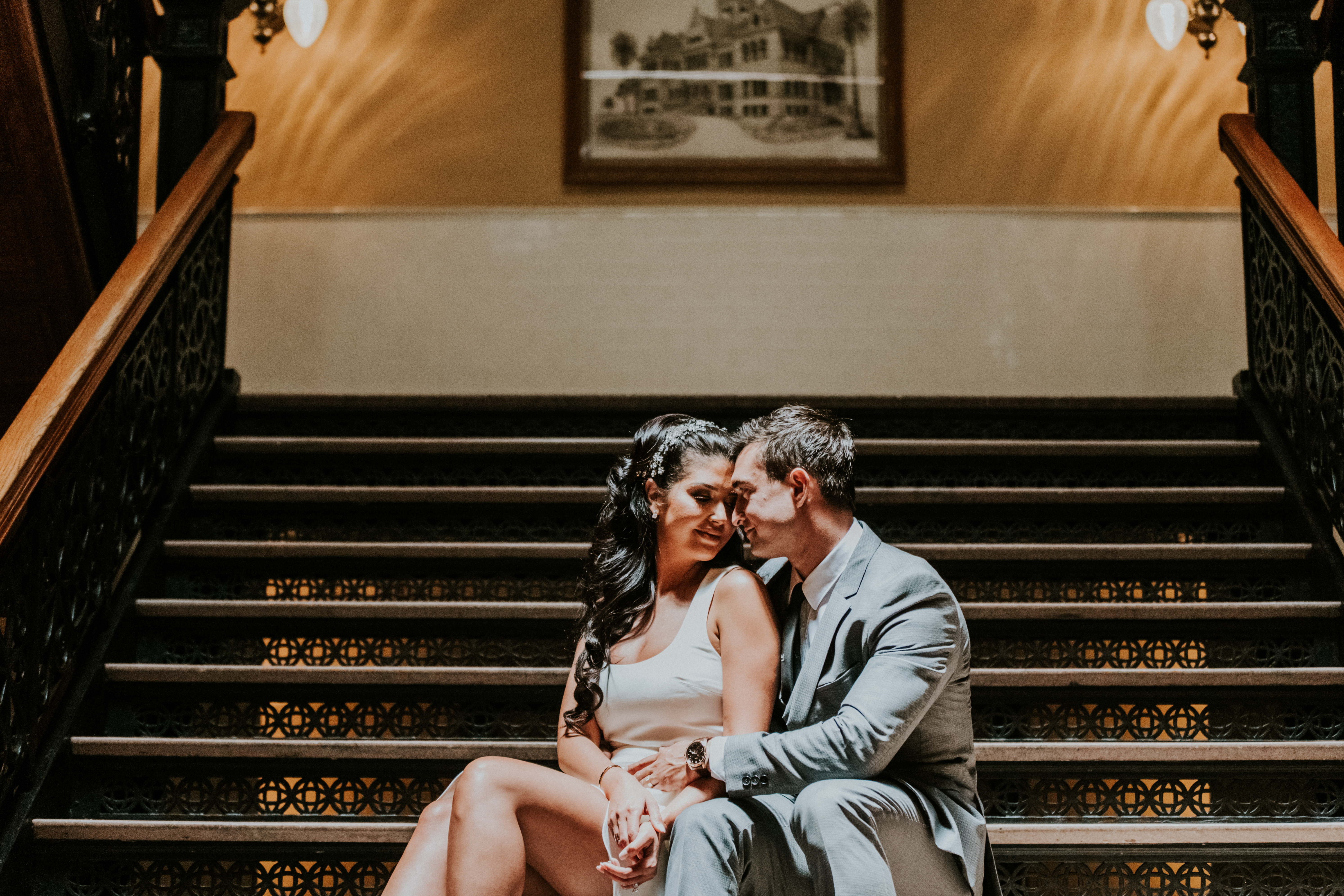 bride and groom posed on stairs courthouse small wedding day photography california wedding photogra
