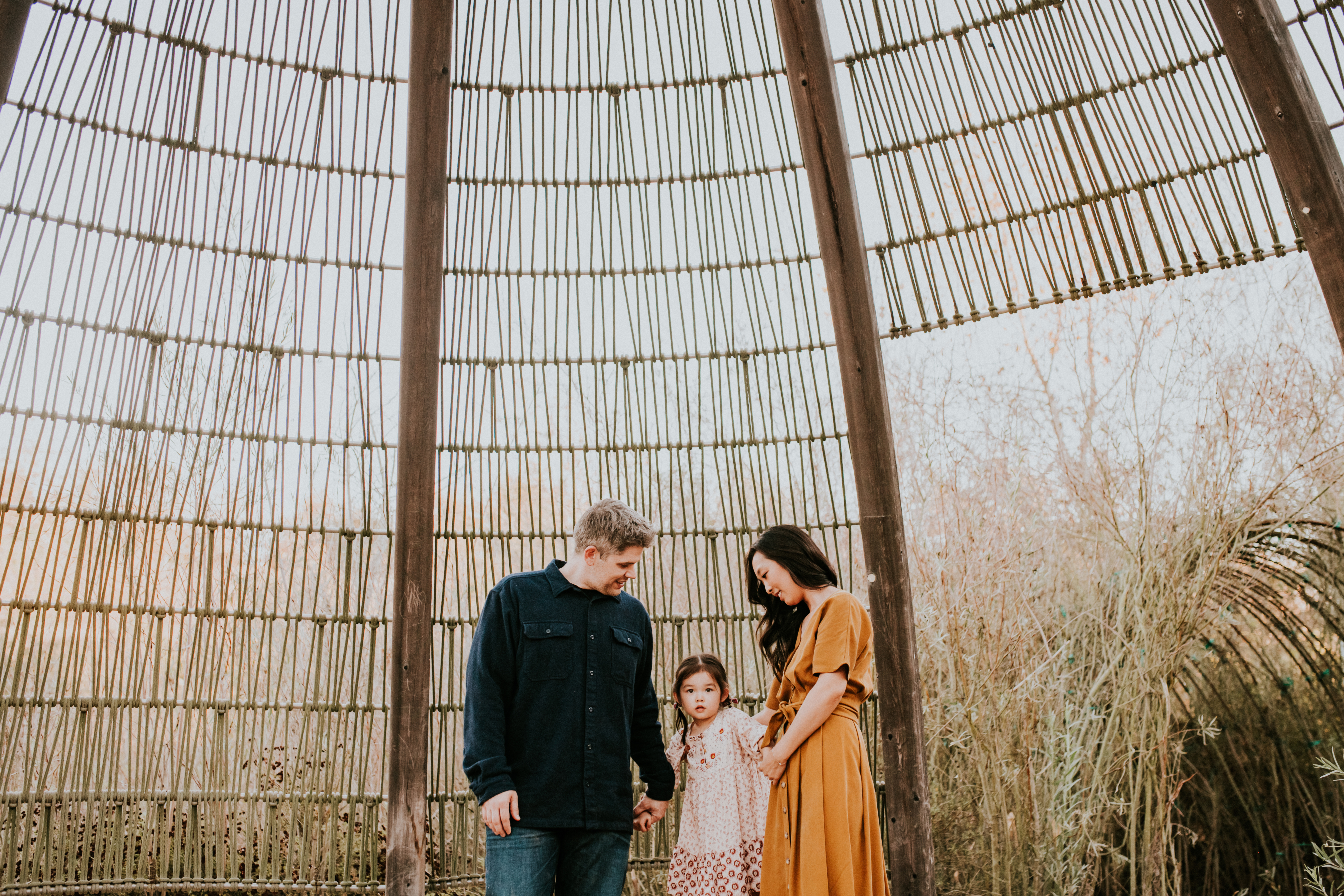 parents looking at daughter in the fall family photography los angeles california