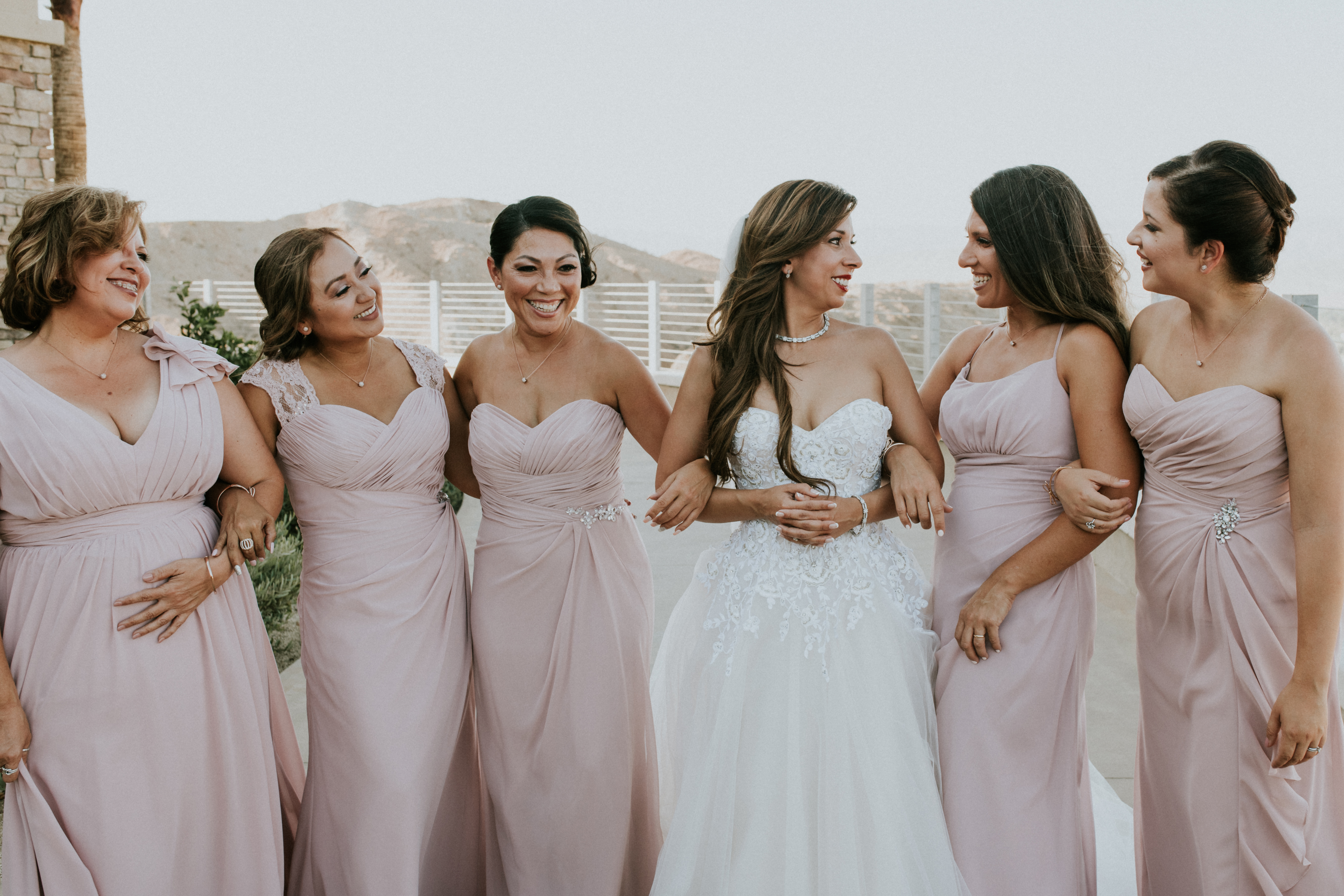 bride with bridal party bridesmaids laughing wedding photography the ritz-carlton rancho mirage