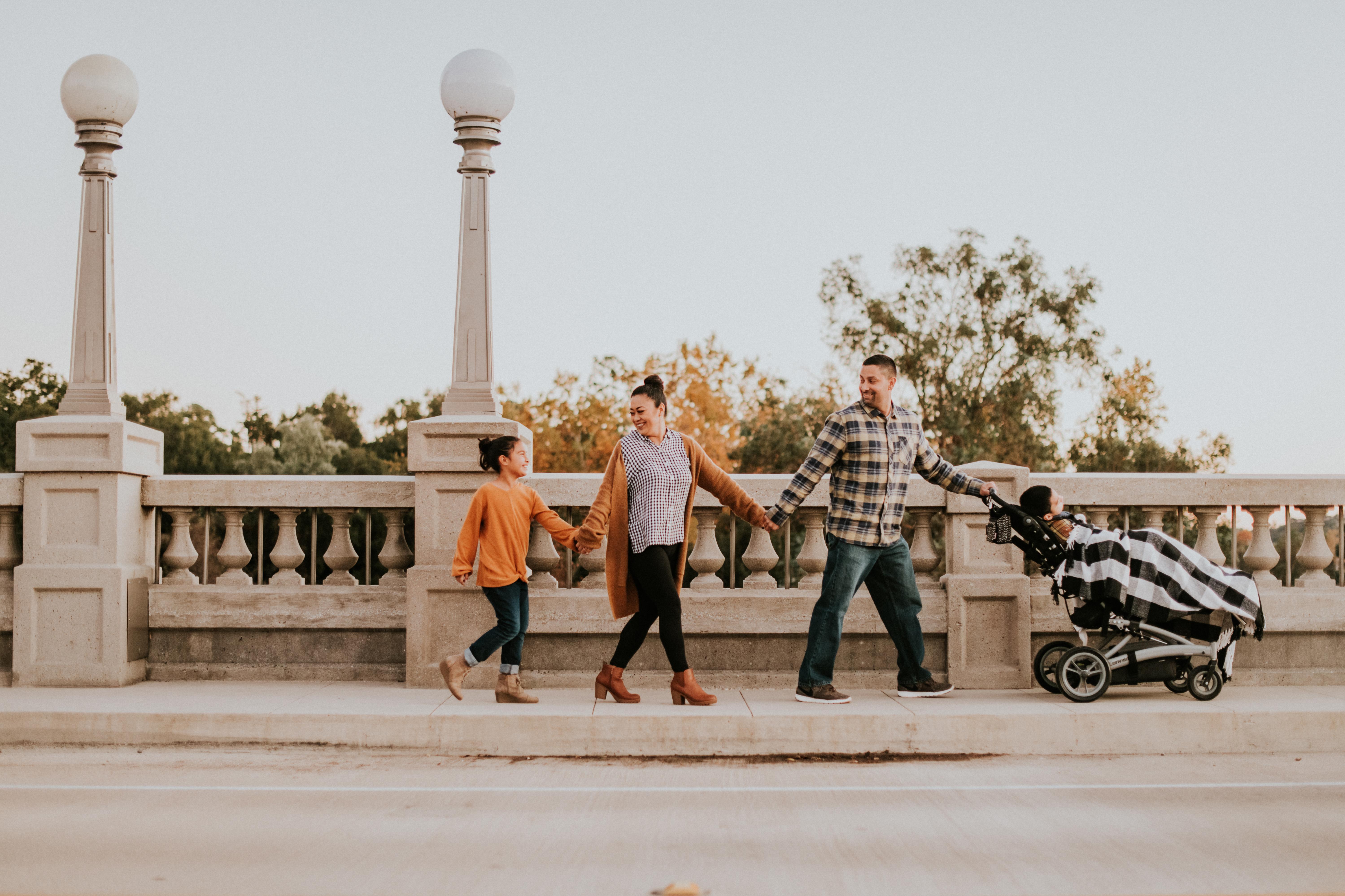 family holding hands on bridge fall photos family photography pasadena california