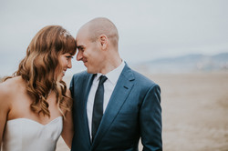 bride and groom forehead to forehead posed on the beach wedding day photography california wedding h