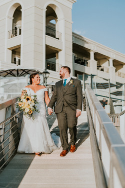 bride and groom walking on a dock california wedding day photography
