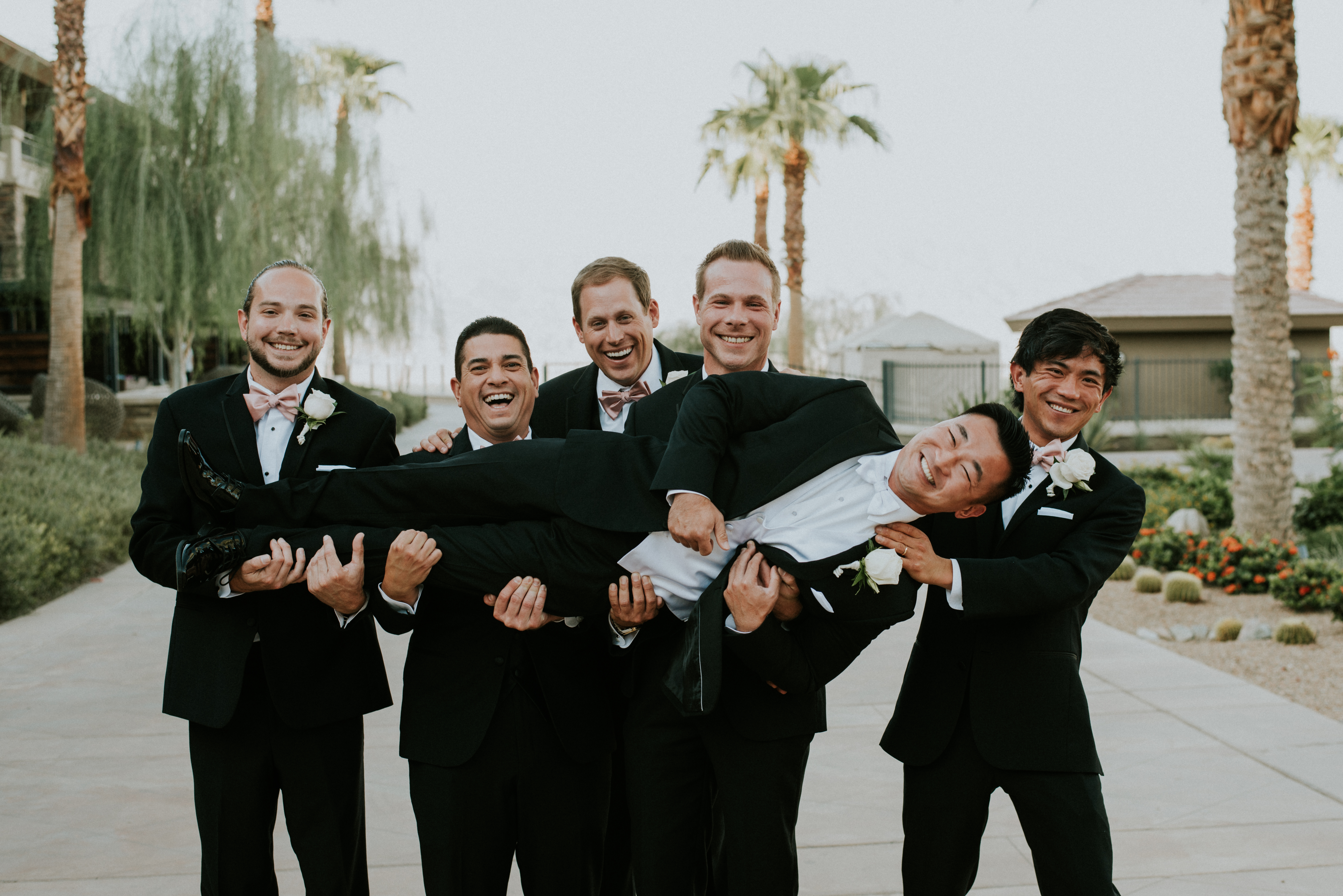 groom and bridal party groomsmen posed funny wedding photography the ritz-carlton rancho mirage