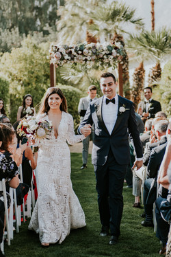 bride and groom walking down the aisle wedding day wedding photography palm springs