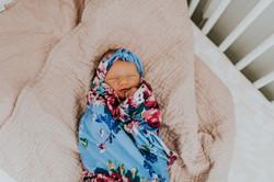 baby girl in crib flower headband at home lifestyle newborn photography los angeles california