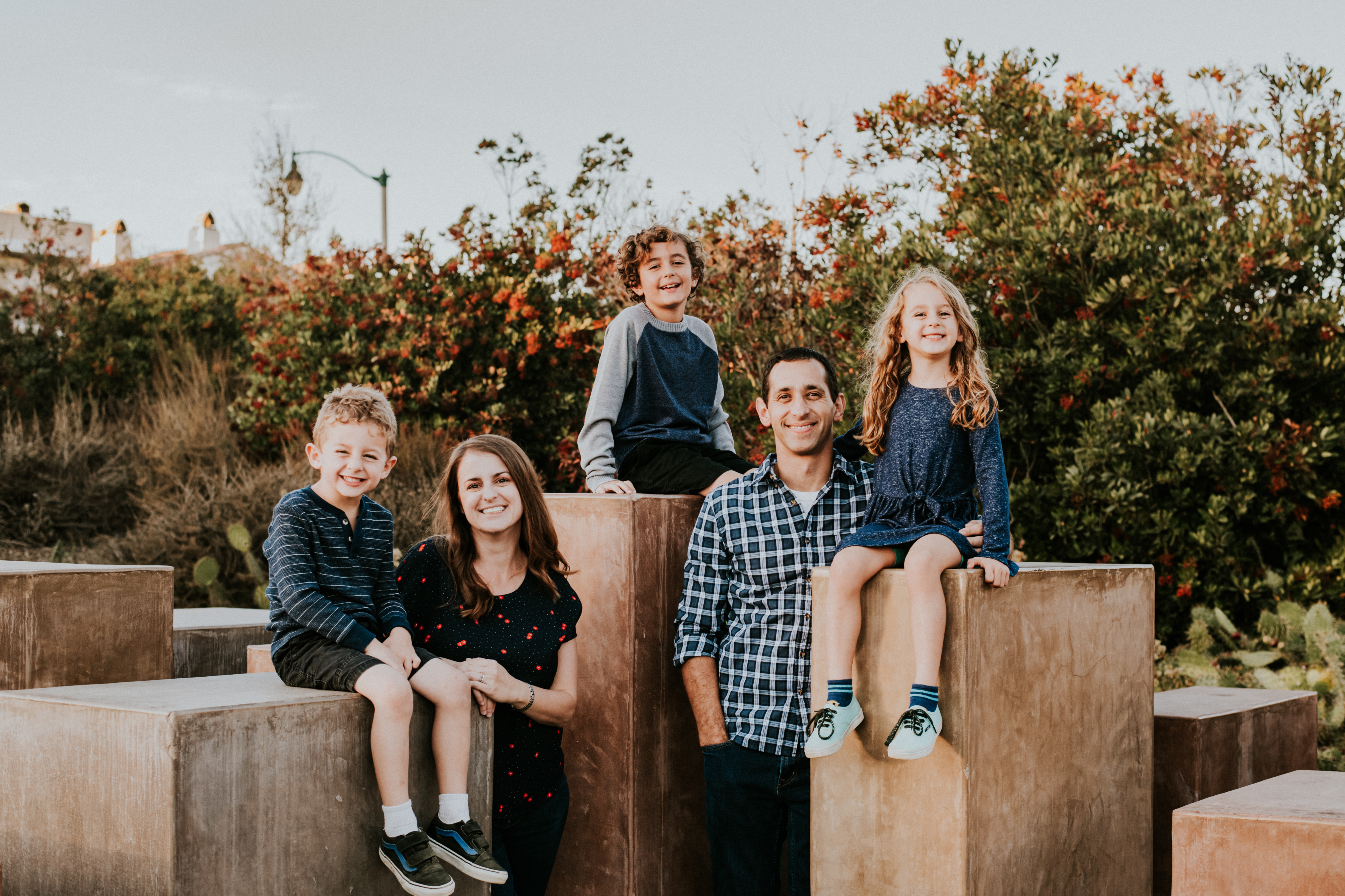 family posed in park family photography los angeles california
