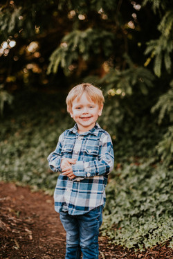 child posed smiling in park family photography los angeles california
