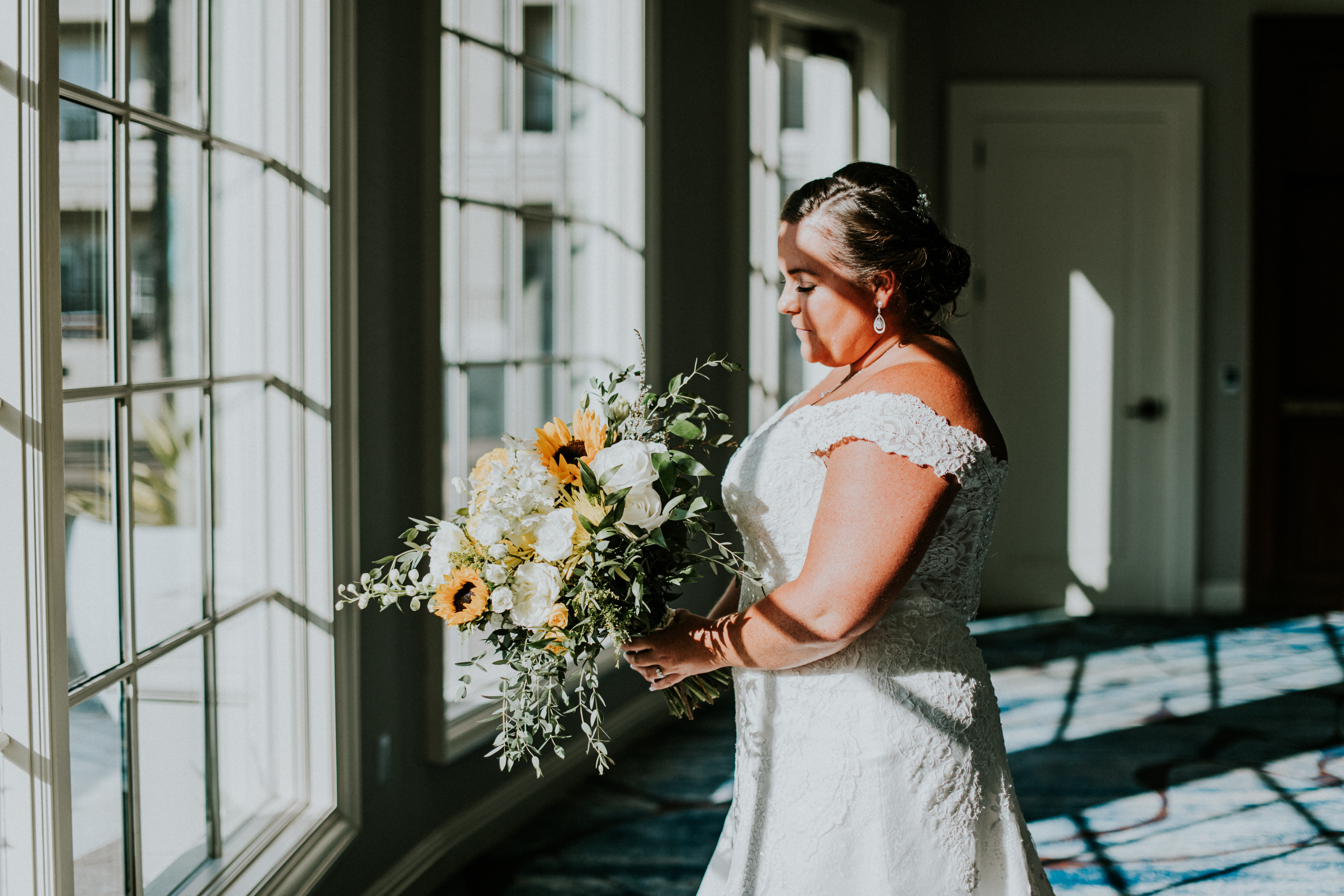 bride in wedding dress posed by window wedding day photography california wedding photographer