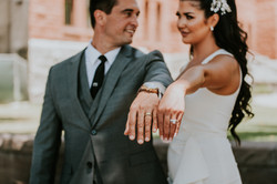 bride and groom posed with wedding rings courthouse small wedding day photography california wedding