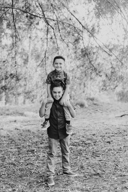 sons brothers on shoulders black and white candid family photography los angeles california