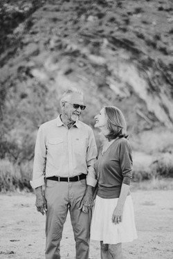 grandma and grandpa in the desert candid looking at each other black and white photo family photogra