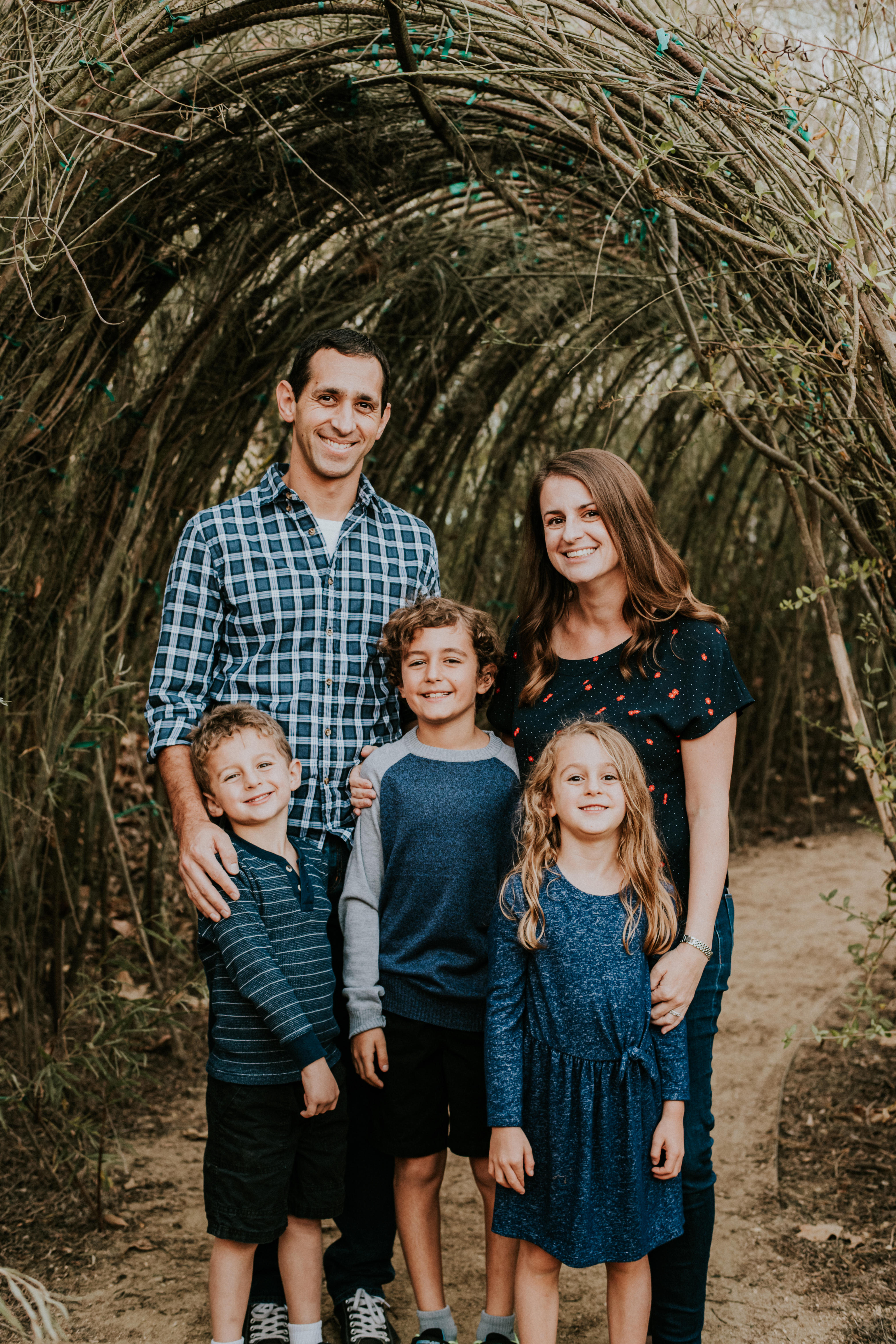 family posed in a park family photography los angeles california