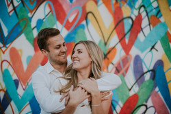 engagement photo shoot posed holding each other city engagement photography love wall los angeles