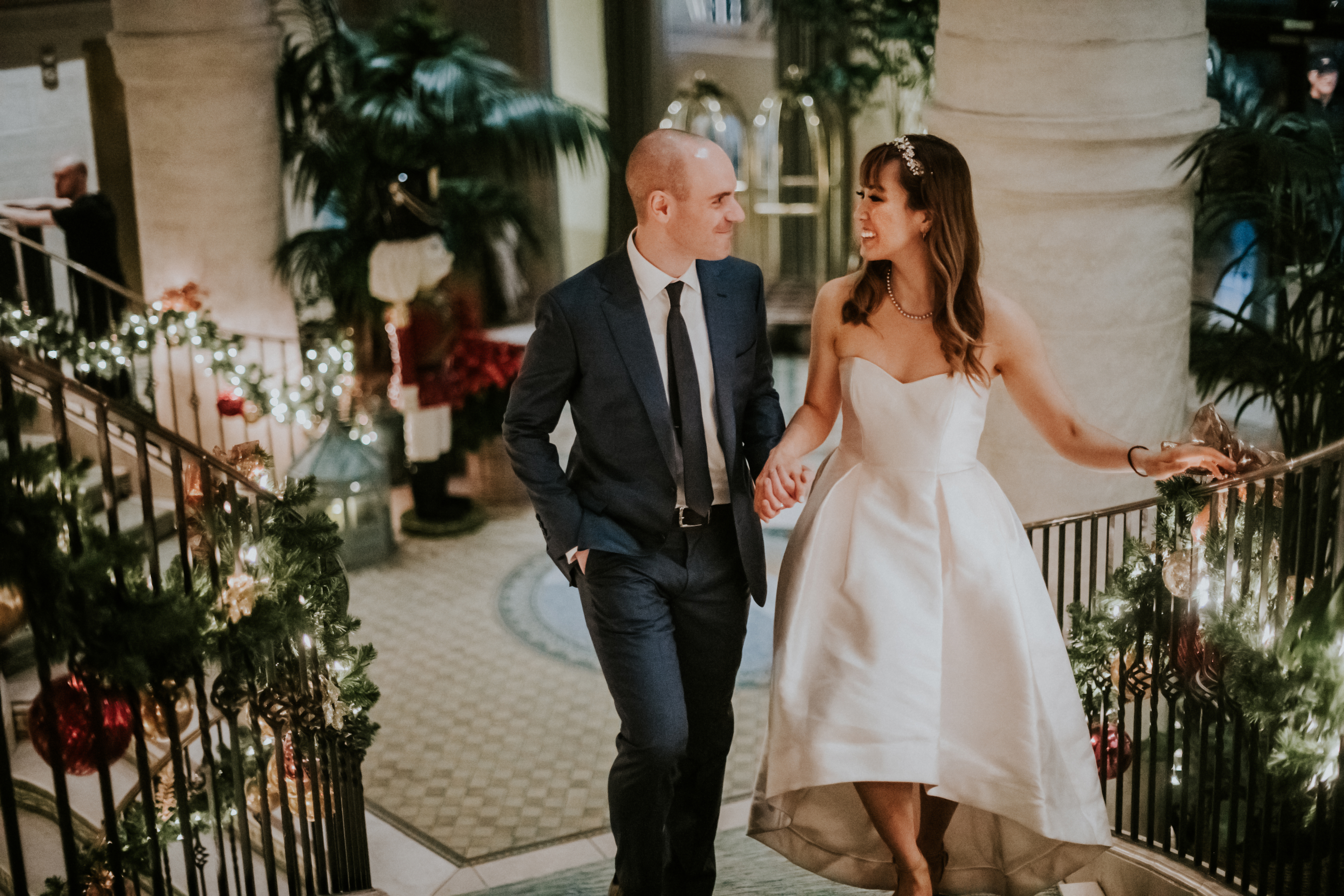 bride and groom walking upstairs of hotel wedding day photography california wedding hotel casa del