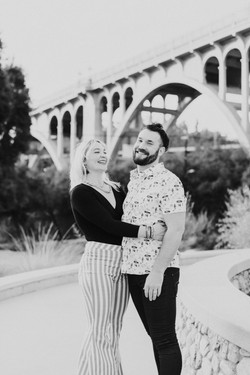 mom and dad laughing candid by bridge family photography pasadena california