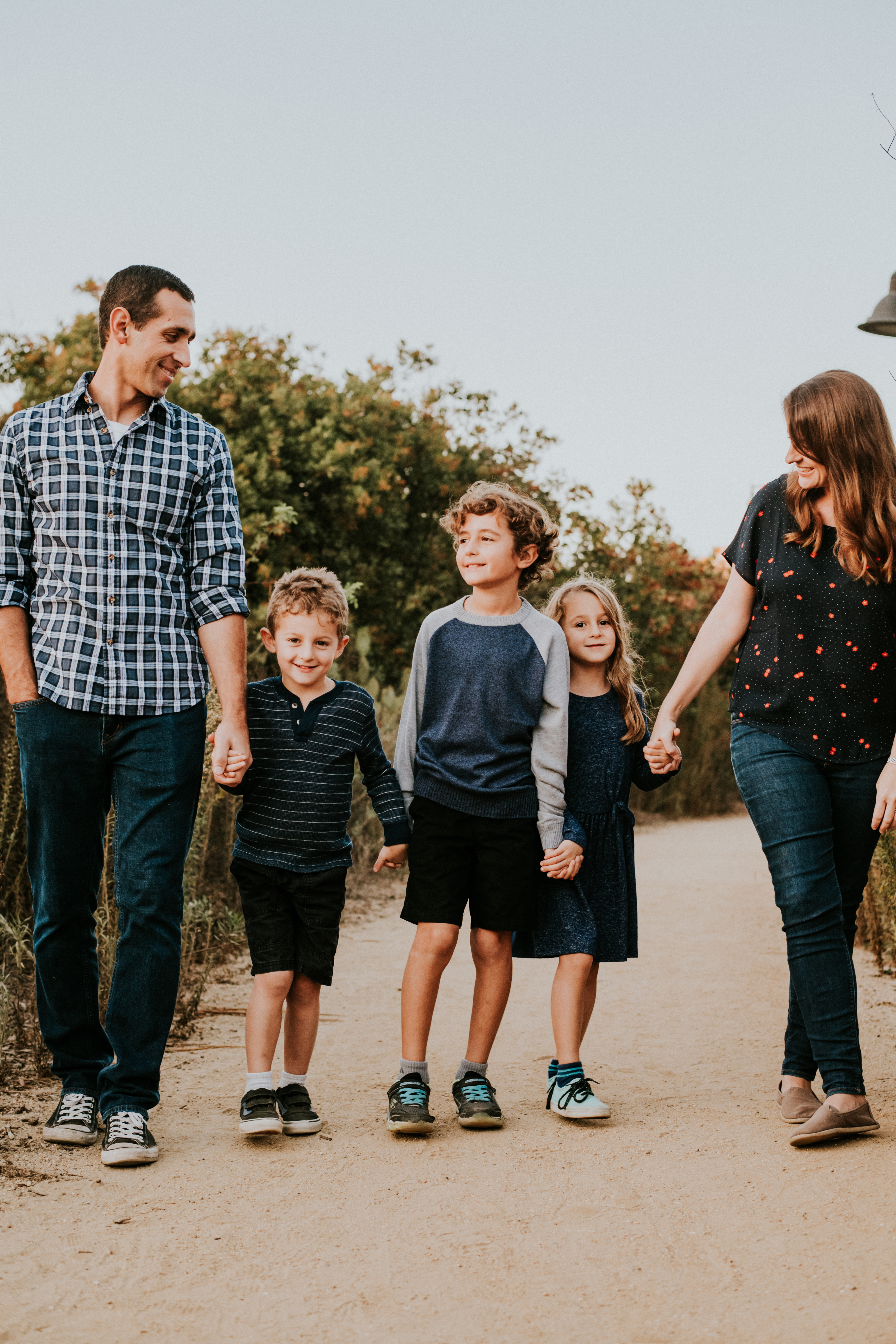 family walking holding hands in park family photography los angeles california