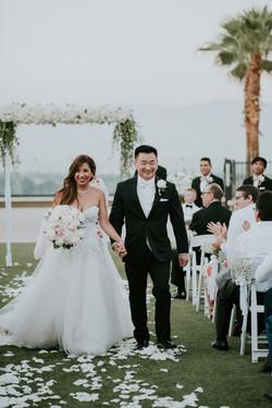 bride and groom walking down the aisle wedding day wedding photography the ritz-carlton rancho mirag