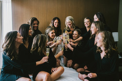 bride and bridesmaids in robes cheers champagne wedding day wedding photography the london west holl