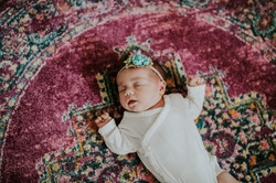 baby girl on rug at home lifestyle newborn photography los angeles california