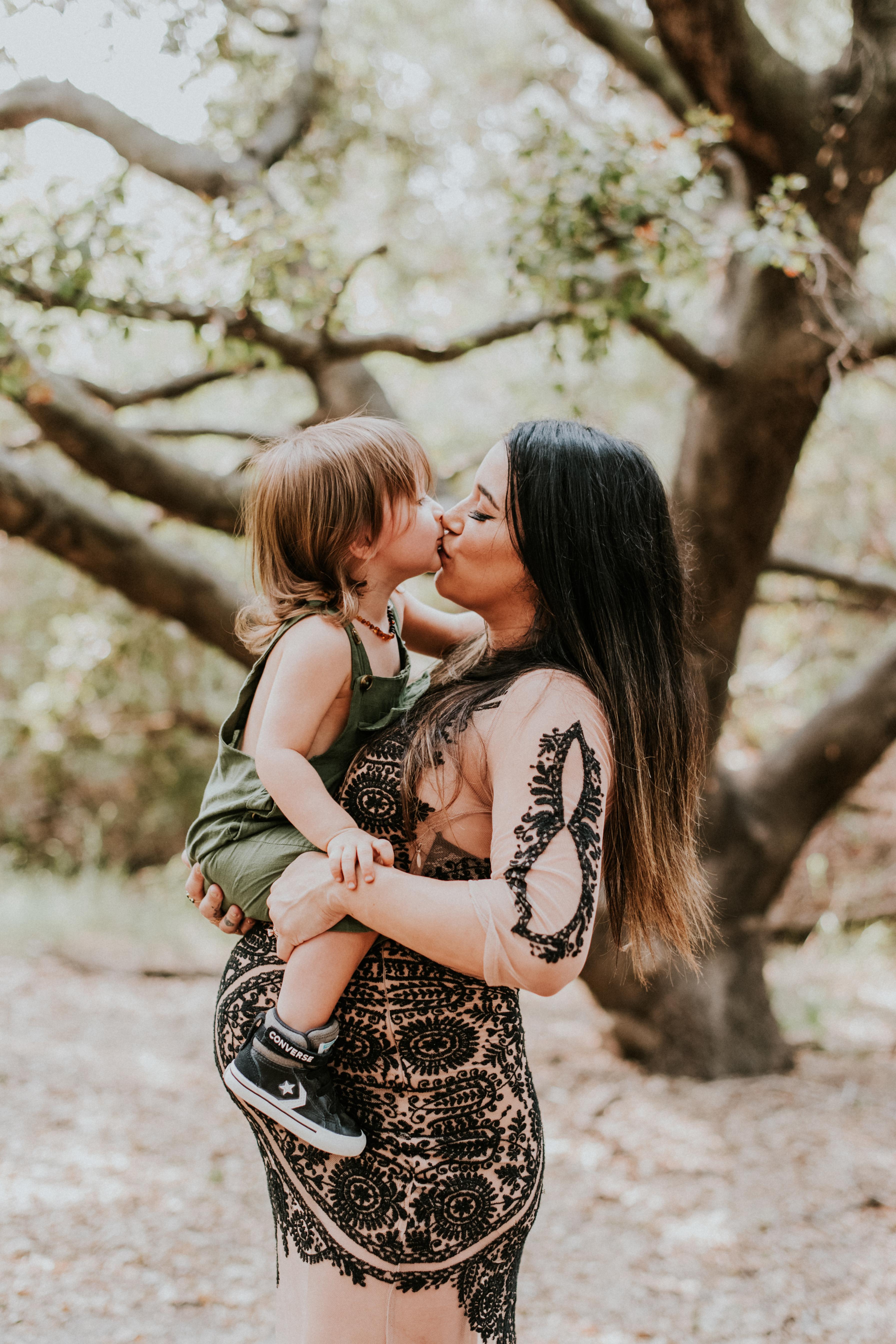 mom kissing son pregnancy photos maternity photography los angeles california