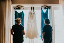 bridesmaids getting ready looking at bridesmaids dress wedding photography california wedding photog