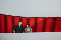 mom and dad posed in front of city wall family photography los angeles california