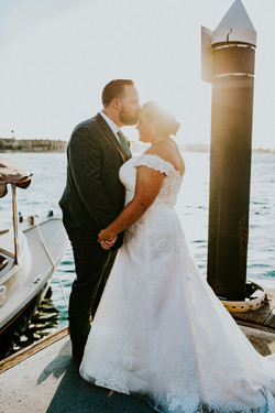 groom kissing bride on the forehead during sunset wedding day photography california wedding photogr