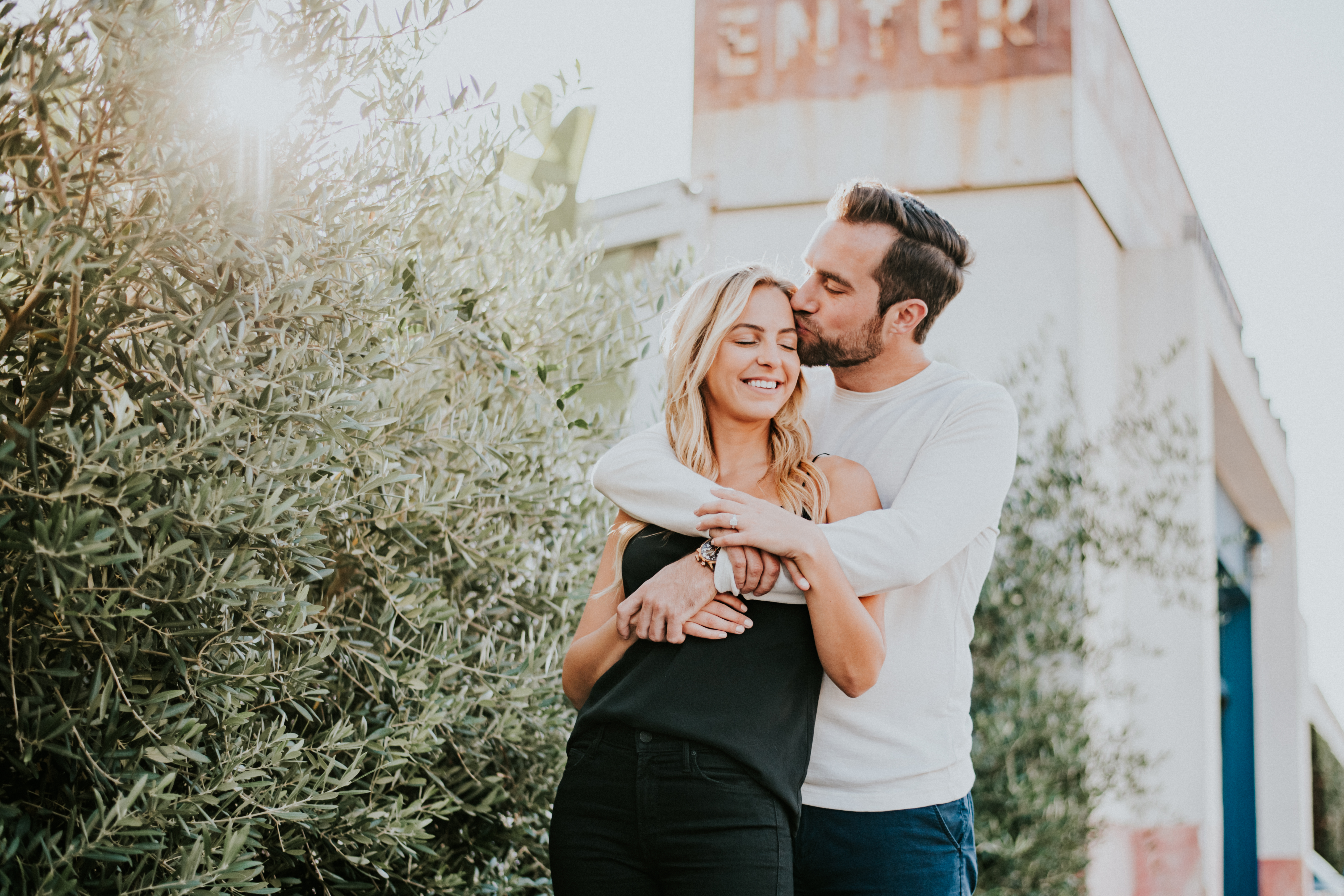 engagement photography photo shoot posed kiss on forehead malibu country mart los angeles