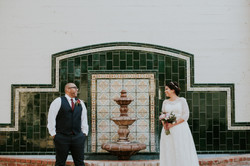 bride and groom posed looking at each other by fountain wedding day photography california wedding p