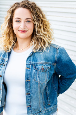los angeles theatrical commercial headshot for female comedy actress blonde natural curly hair jean
