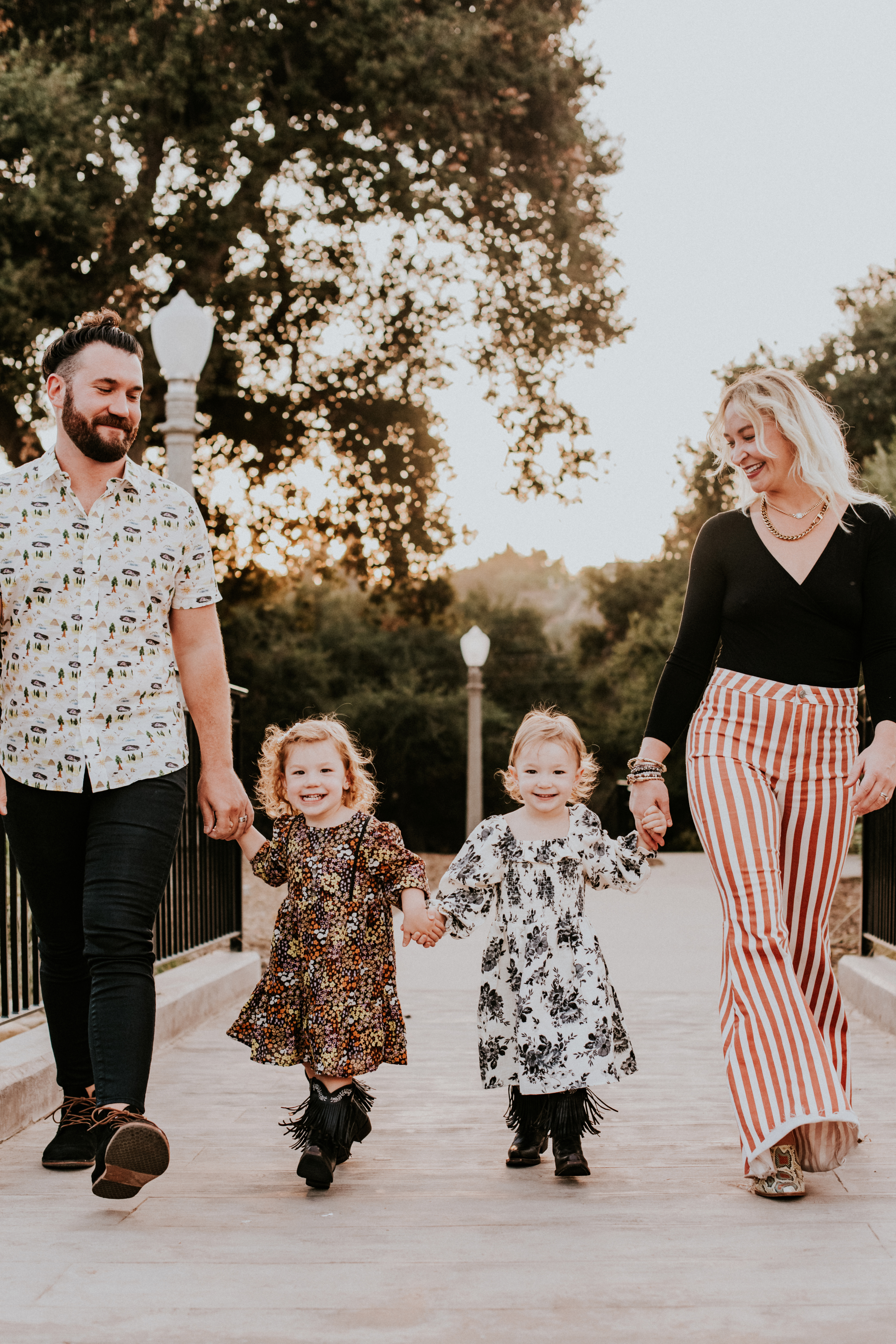 candid of family walking holding hands in park family photography pasadena california