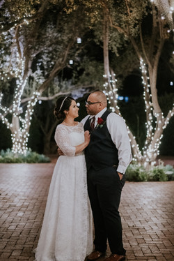 bride and groom posed by string lights wedding day photography california wedding photographer