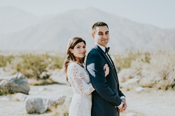 bride and groom posed in desert wedding day wedding photography palm springs