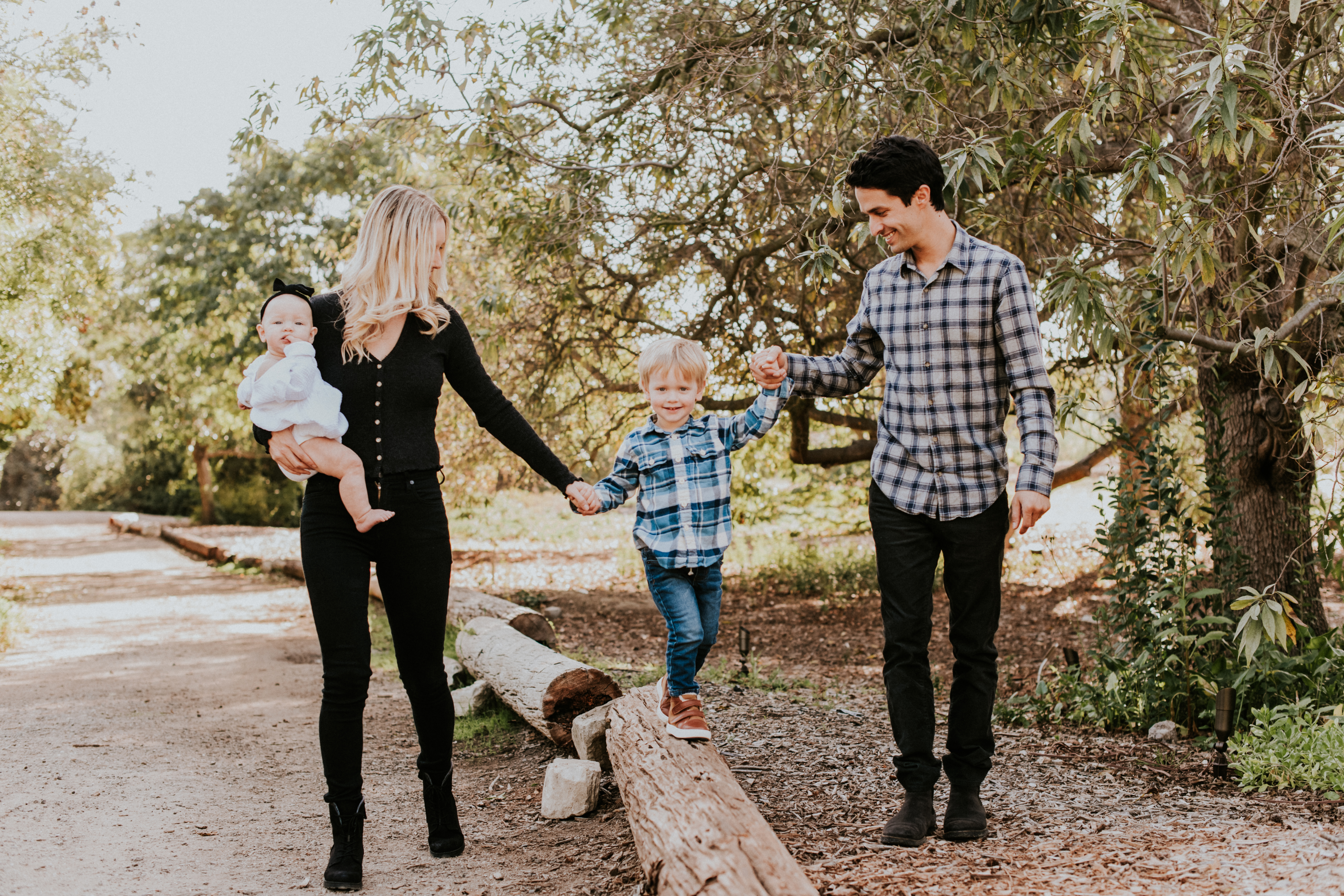 family holding hands walking in park family photography los angeles california
