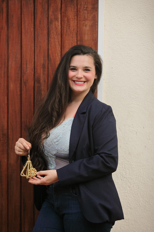 Autumn Seibel with golden pendant