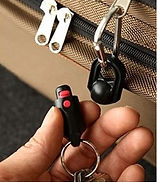 Key Wonder Magnetic Quick Release Keychain on Luggage Open in Hand