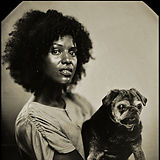 Black and white photo of Ginger Ewing holding a pug