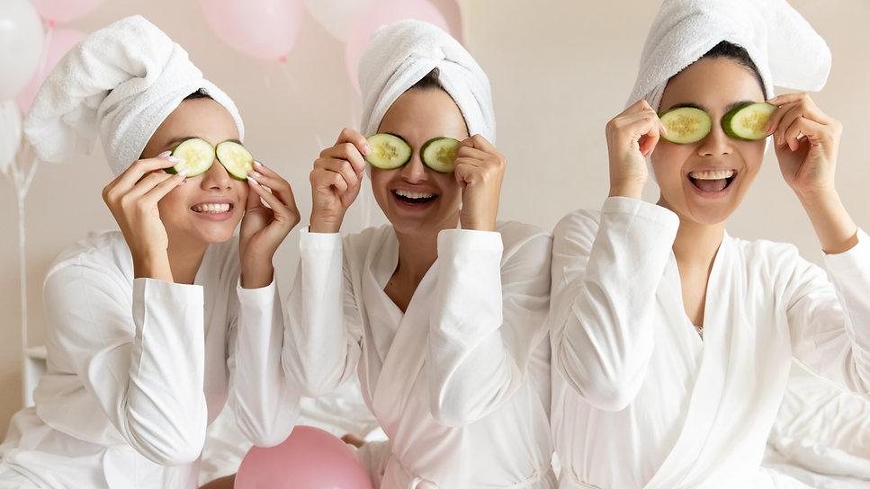 Happy young women wear white bathrobes t