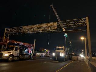 Overhead sign install - night example photo