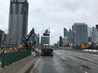 Temporary construction bins - flatbed crane