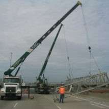 Overhead signs - crane lifting highway sign holder