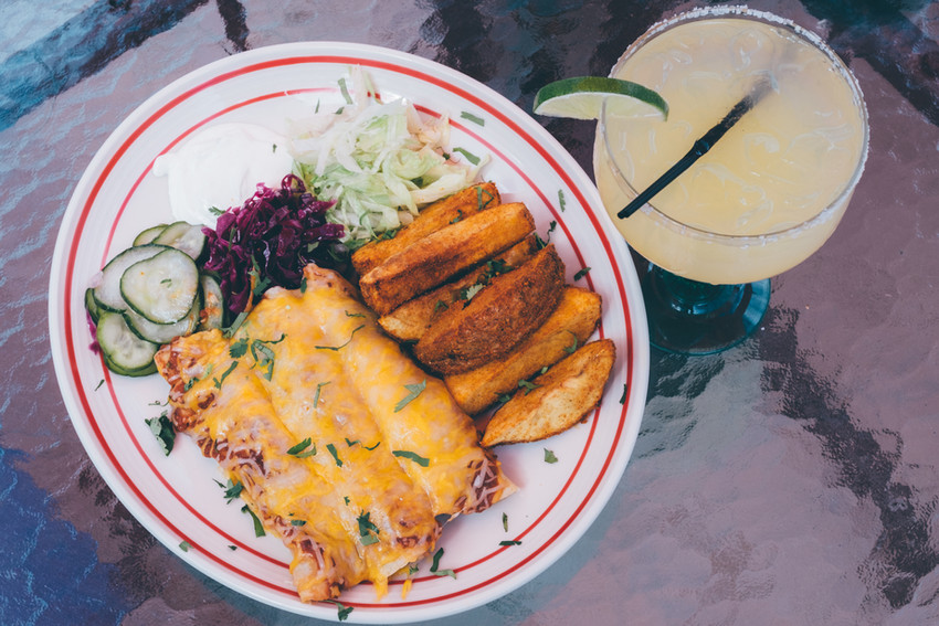 Enchiladas served alongside Mexican Potatoes